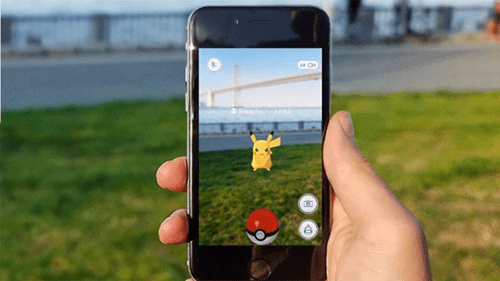 Mobile phone and Pokemon Go Game on the screen